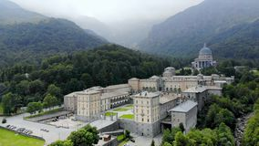OROPA, BIELLA, ITALY - JULY 7, 2018: aero View of beautiful Shrine of Oropa, Facade with dome of the Oropa sanctuary. Located in mountains near the city of stock footage