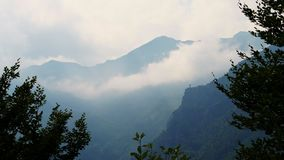 OROPA, BIELLA, ITALY - JULY 7, 2018: peaks of the alpine mountains in the fog. summer evening, twilight. Alpine. OROPA, BIELLA, ITALY - JULY 7, 2018: peaks of stock footage