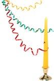 Oropel celebrador multicolor y vela del Año Nuevo Imagen de archivo libre de regalías