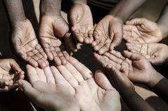 Orphan and adoption symbol. Caucasian and African Ethnicity Hand. Caucasian and African Ethnicity Hands Asking for Help Symbol Stock Image
