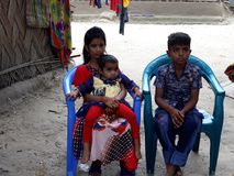 Orphan Child. 3 Orphans  Child who are lost them mother Stock Photo