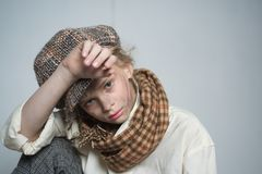 Orphanage. teen girl in retro male suit. retro fashion model. Vintage. old fashioned child in beret. street kid with. Dirty face. vintage english style. Homelss stock photo