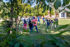 Orphans playing and dancing together with tourists Royalty Free Stock Photos