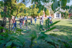 Orphans playing and dancing with tourists Royalty Free Stock Photo