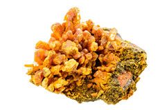 Orpiment mineral sample. A rich yellow orpiment mineral sample isolated on white Stock Images