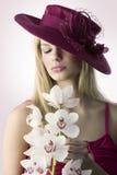 A orquídea e a menina Imagem de Stock Royalty Free