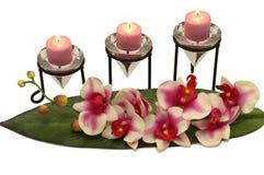 Orquídea y velas Fotografía de archivo libre de regalías