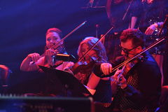A orquestra do quadrado vermelho executa na fase durante concerto do aniversário do ano de Viktor Drobysh o 50th em Barclay Cente Imagens de Stock Royalty Free