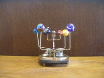 Orrery clock with 8 planets. Stock Photo