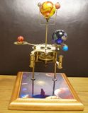 Orrery steampunk art clock with planets of the solar system. I made this steampunk art orrery clock.I made this with a vintage 1950s brass clock movement and stock photography