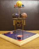 Orrery steampunk art clock with planets of the solar system. I made this steampunk art orrery clock.I made this with a vintage 1950s brass clock movement and stock image