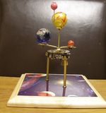 Orrery steampunk art clock with planets of the solar system. I made this steampunk art orrery clock.I made this with a vintage 1950s brass clock movement and stock photo
