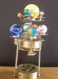 Orrery steampunk art clock with planets of the solar system. I made this steampunk art orrery clock.I made this with a vintage 1950s brass clock movement and royalty free stock images