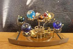 Orrery steampunk art clock with planets of the solar system. Royalty Free Stock Photo