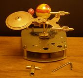 Orrery steampunk art clock with planets of the solar system. Stock Photo
