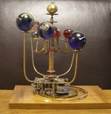 Orrery Steampunk Art Clock With 8 Planets & Sun. I made this steampunk art clock with a vintage 1950s brass clock movement in good working order & antique brass royalty free stock images