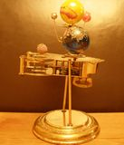 Orrery Steampunk Art clock and platent. Stock Photo