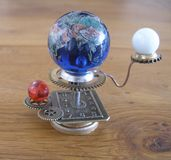 Orrery steampunk art small sculpture for dolls house. Stock Photos
