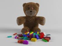 Orsacchiotto e giocattoli Fotografie Stock