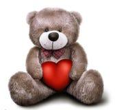 Orsacchiotto molle del giocattolo con il cuore del biglietto di S. Valentino Immagine Stock