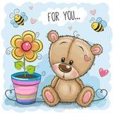 Orso con il fiore su un fondo blu royalty illustrazione gratis