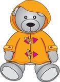 Orso dell'orsacchiotto in cappotto giallo Fotografia Stock