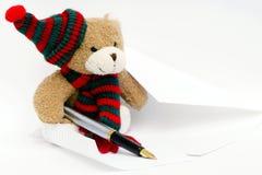 Orso dell'orsacchiotto che gradice scrivere fotografia stock