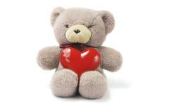 Orso dell'orsacchiotto con il cuore di amore Immagini Stock