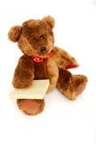 Orso dell'orsacchiotto con il post-it e la matita Fotografia Stock