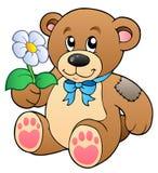 Orso di orsacchiotto sveglio con il fiore illustrazione di stock