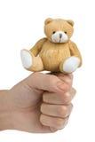 Orso e pugno del giocattolo Fotografia Stock