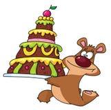 Orso e torta Fotografie Stock