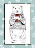 orso polare con la tazza ed i fiocchi di neve rossi su fondo blu Concetto di Natale Fotografia Stock