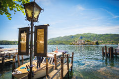 Orta lake boat docks and lamppost with timetables to the San Giulio island Stock Images