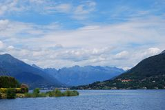 Orta lake, Italy. Panoramic view of Orta lake in summer with Alps mountains in background, Piedmont, Italy Stock Image