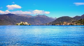 Orta Lake landscape. Orta San Giulio village and island Isola S. Orta Lake landscape. Orta San Giulio village, island Isola S.Giulio and Alps mountains view Royalty Free Stock Photography