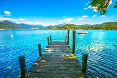 Orta Lake landscape. Wooden pier or jetty and Orta San Giulio vi. Llage and island, Piedmont, Italy, Europe Royalty Free Stock Photography