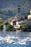 Orta San Giulio island with swimmers Stock Photo