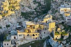 Ortahisar洞城市在卡帕多细亚,日落的土耳其 图库摄影