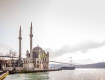 Ortakoy, Istanbul. Istanbul, Turkey - January 6, 2016: View of the famous Ortakoy Mosque and the Bosphorus Bridge in winter time from Ortakoy coast on January 6 Royalty Free Stock Image