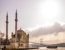 Ortakoy, Istanbul. Istanbul, Turkey - January 6, 2016: View of the famous Ortakoy Mosque and the Bosphorus Bridge in winter time from Ortakoy coast on January 6 Stock Photos