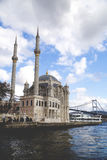Ortakoy, Istanbul. Istanbul, Turkey - January 6, 2016: View of the famous Ortakoy Mosque under construction and the Bosphorus Bridge in winter time from Ortakoy Stock Photos