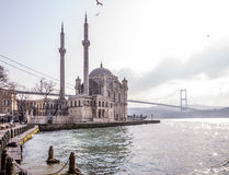 Ortakoy, Istanbul. Istanbul, Turkey - January 6, 2016: View of the famous Ortakoy Mosque under construction and the Bosphorus Bridge in winter time from Ortakoy Royalty Free Stock Images