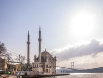 Ortakoy, Istanbul. Istanbul, Turkey - January 6, 2016: View of the famous Ortakoy Mosque under construction and the Bosphorus Bridge in winter time from Ortakoy Royalty Free Stock Photography