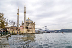 Ortakoy, Istanbul. Istanbul, Turkey - January 6, 2016: View of the famous Ortakoy Square, Mecidiye Mosque and the Bosphorus Bridge in winter time from Ortakoy Stock Photo