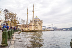 Ortakoy, Istanbul. Istanbul, Turkey - January 6, 2016: View of the famous Ortakoy Square, Mecidiye Mosque and the Bosphorus Bridge in winter time from Ortakoy Royalty Free Stock Photo