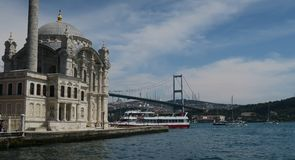 Ortakoy Mosque with Bosphorus Bridge - Connection between Europe and Asia in Istanbul, Turkey. Ortakoy Mosque at the European Side of Istanbul, with the Stock Photos