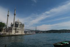 Ortakoy Mosque with Bosphorus Bridge - Connection between Europe and Asia in Istanbul, Turkey. Ortakoy Mosque at the European Side of Istanbul, with the Stock Images