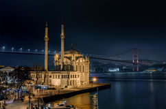 Ortakoy Mosque and the Bosphorus Bridge at night Stock Photography