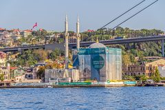 Ortakoy Mosque. ISTANBUL, TURKEY - SEPTEMBER 29, 2013: View of the Ortakoy Mosque in restoration and First Bosphorus Bridge, sailling Bosporus Stock Photography